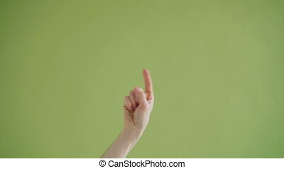 Close-up shot of hand pointing at camera making come here gesture with thumbs-up