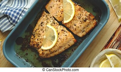 Close up shot of healthy grilled salmon served in heat proof...