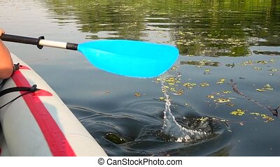 Close up shot of Man's arm in kayak with paddle. Slow motion...
