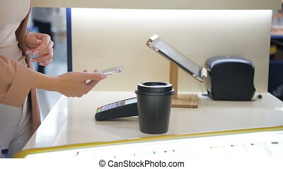 Close-up shot of man's hand makes takeaway coffee for a...