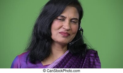 Close up shot of mature happy beautiful Indian woman as call...