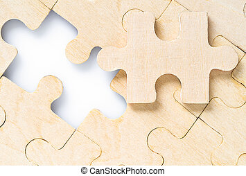 Missing jigsaw puzzle pieces on white