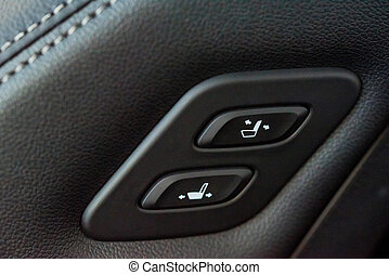 Close up shot of modern car central console with seat controls