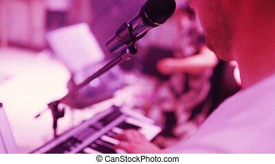 musician playing keyboards