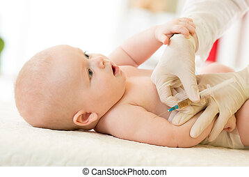 Close-up shot of pediatrician giving baby intramuscular...