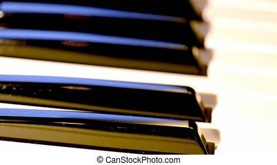 Close- up shot of piano keys.