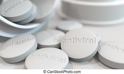 Close-up shot of pills with stamped ANTIVIRAL text on them. 3D animation