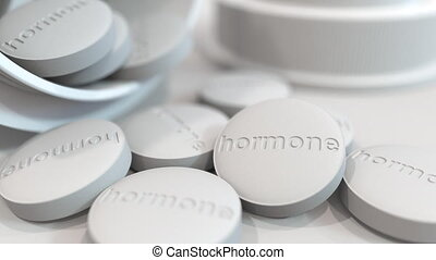 Close-up shot of pills with stamped HORMONE text on them. 3D animation