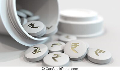 Close-up shot of pills with stamped Indian rupee INR symbol...