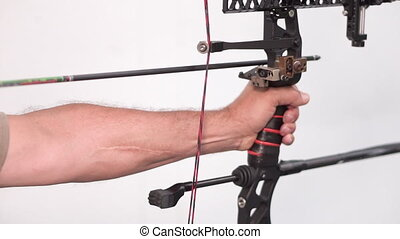 Close up shot of pro archer shooting arrow with mechanic bow...