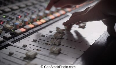 Close up shot of professional dj's hands working with a...