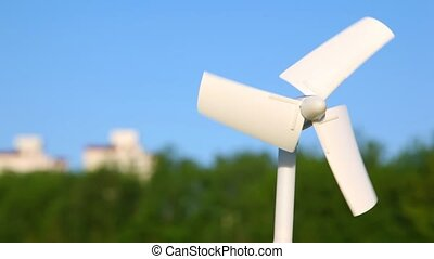 close-up shot of rotating wind driven generator, against...