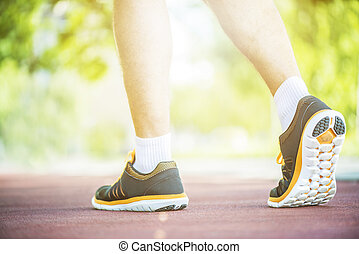 Close up shot of runner's shoes - A person running outdoors ...