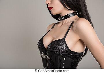 Close-up shot of sensual gothic girl in black fetish corset