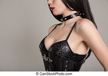 Close-up shot of sensual gothic girl in black fetish corset