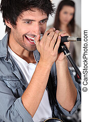 close-up shot of singer holding microphone