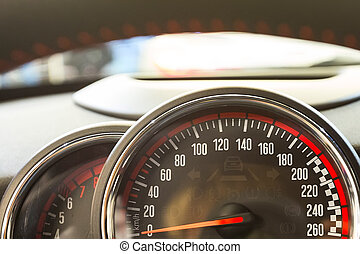 Close up shot of speedometer in a car.