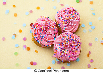 close up shot of strawberry cupcakes with sprinkles