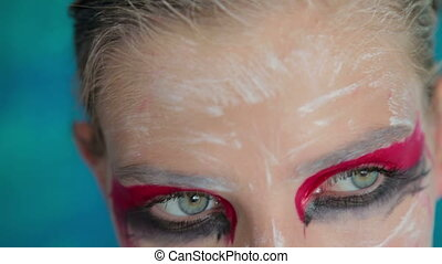 Close up shot of teen girl's eyes with creative unusual makeup
