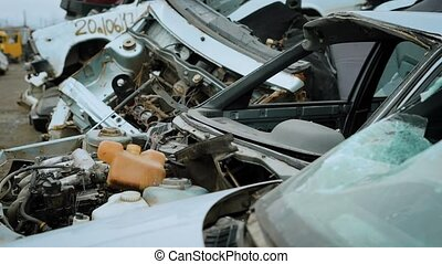 close up shot of the car without the hood, the transport has no mirrors, it is located in a scrap heap