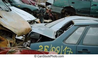 close up shot of the cars that are in the landfill of...