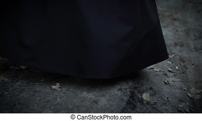 close up shot of the feet of a woman who walks barefoot...