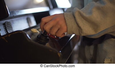 close up shot of the hand of a man pushing buttons on an electronic slot machine