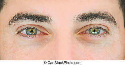 Close up shot of the man's eyes.