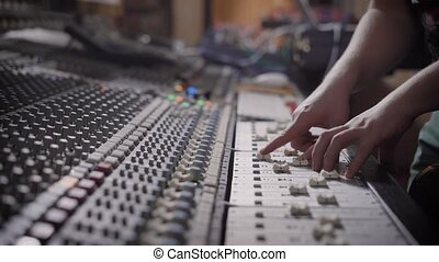 close up shot of the man's hands, who writes music in the...