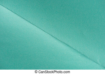 close-up shot of turquoise color folded paper for background