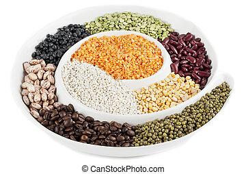 Close-up image of variety of food grains arranged in plate against white background.