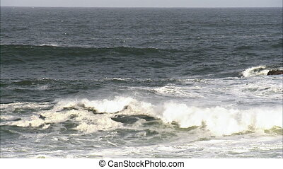 Close up shot of waves lapping on the shore