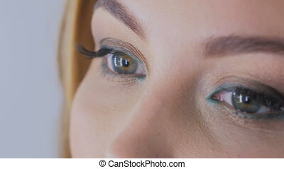 Close up shot of woman's eyes with professional makeup