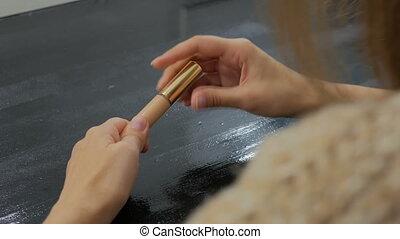 Close up shot of womans hands opening contour face makeup...