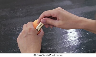 Close up shot of womans hands opening contour face makeup concealer tool