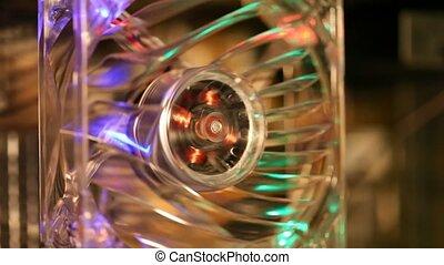 close-up shot of working computer mini fan with LED illumination