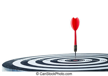 Close up shot red dart arrow on center of dartboard Isolated on white background