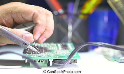 Close up shot soldering a circuit b