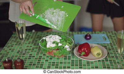 Close up shot woman holding a plate of fresh green salad vegetarian food. Healthy and diet concept
