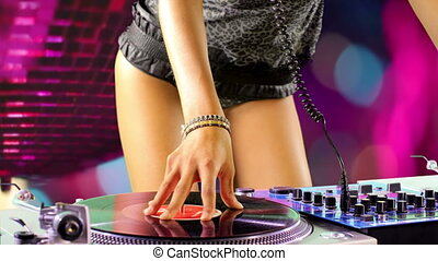 close up shots of sexy female dj dancing and playing records