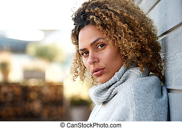 side portrait of beautiful african american woman staring