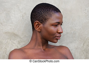 side portrait of beautiful african woman with naked shoulders