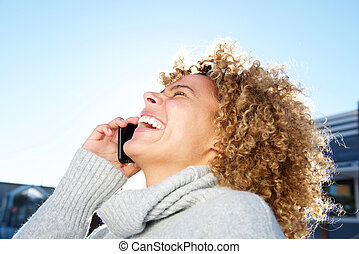 happy african american young woman talking on cellphone