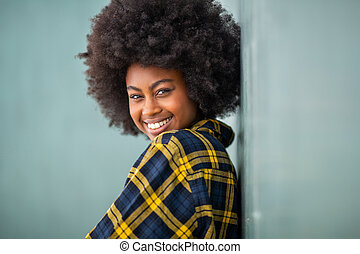 young black woman with afro hair looking over shoulder