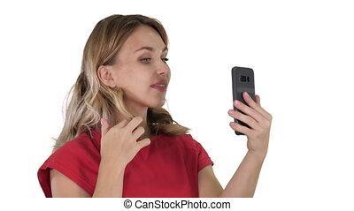 Beautiful woman preen using her phone like a mirror on white...