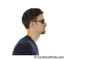 Close up. Side view. Blind young man walking on white background. Professional shot in 4K resolution. 53. You can use it e.g. in your medical, commercial video, business, presentation, broadcast