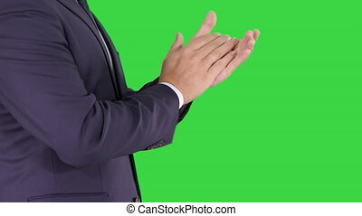 Business man clapping hands on a Green Screen, Chroma Key. -...