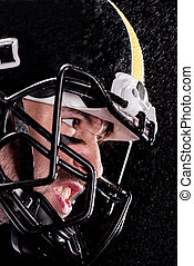 Close-up side view of angry man american football player in helmet