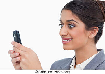 Close up side view of female entrepreneur reading text message