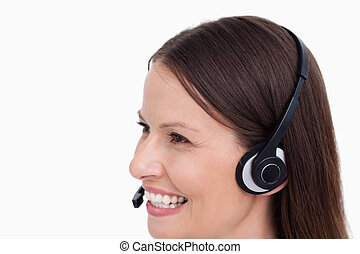 Close up side view of smiling female call center agent